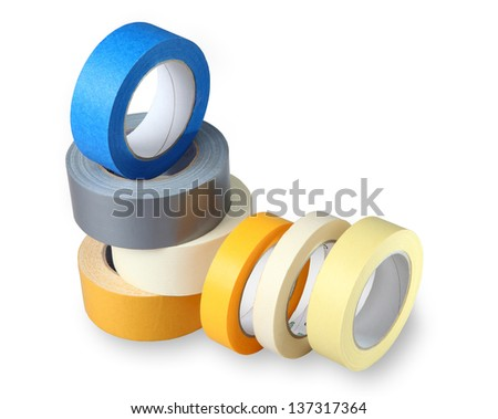 Seven coils of colored adhesive tape  - stock photo