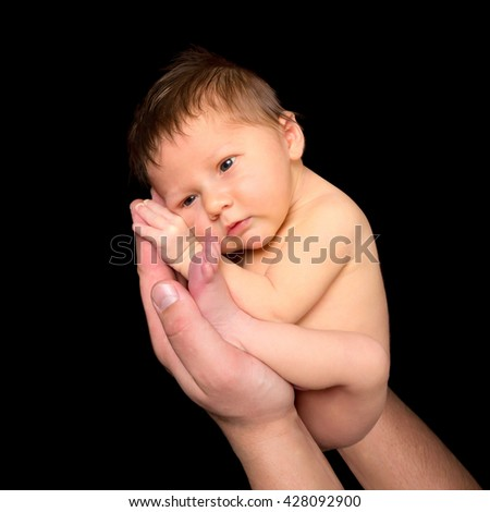 Seven days old newborn baby in the hands of his father - stock photo