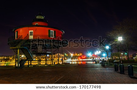 Seven Foot Knoll Lighthouse at night, in the Inner Harbor, Baltimore, Maryland. - stock photo