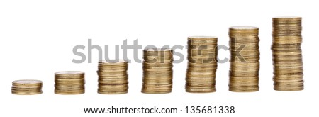 Seven golden coin stacks in an inclining height, representing financial growth. Isolated on white background. - stock photo