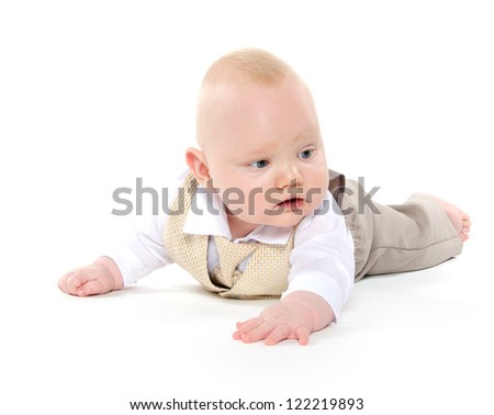 Seven-month-old baby boy in dress clothes for the holidays on white background