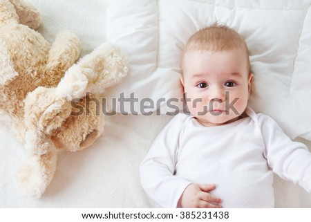seven month old baby in the bed - stock photo