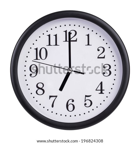 Seven o'clock on the dial round clock - stock photo
