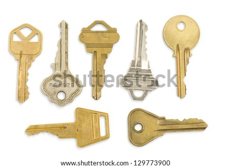 Seven old keys on white suitable for steam punk projects