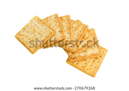 seven pieces of crackers on white background - stock photo