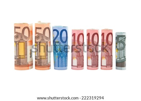 seven Rolled up euro banknotes - stock photo