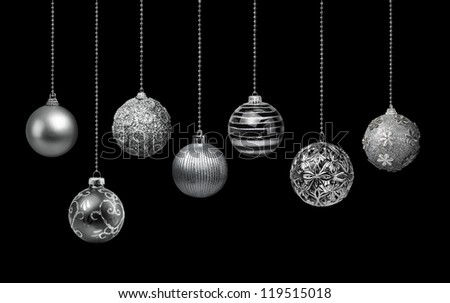 Seven silver decoration Christmas balls collection hanging, black background isolated - stock photo
