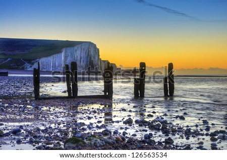 Seven Sisters cliffs during Winter sunrise - stock photo