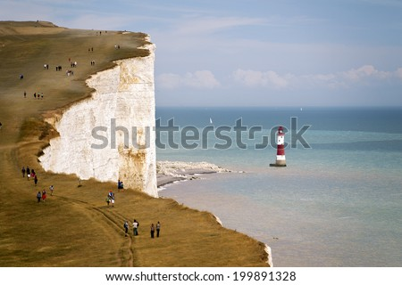 Seven Sisters National Park, view of the cliffs, lighthouse and the beach, East Sussex, England, UK - stock photo