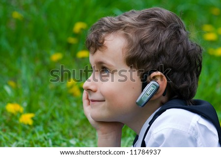 Seven years old businessman with mobile technology