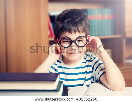 seven years old child reading a book at home - stock photo