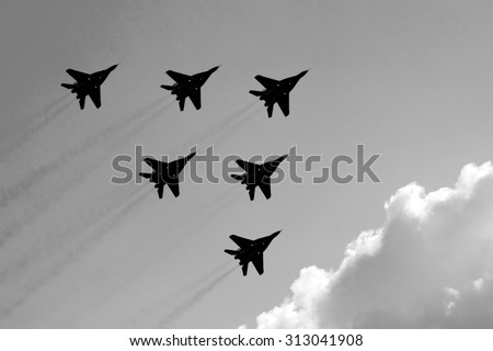 several aircraft in the sky.black and white - stock photo