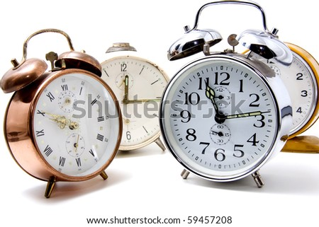 several alarm clocks over white background - stock photo