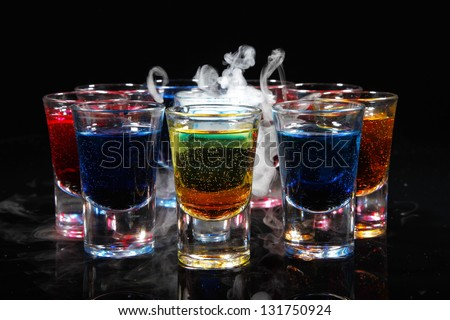 Several alcohol shots - stock photo
