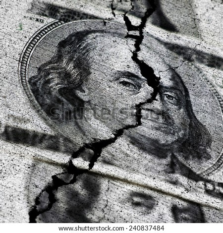 Several American Dollars ripped or torn in half symbolizing the destruction of the economy - stock photo