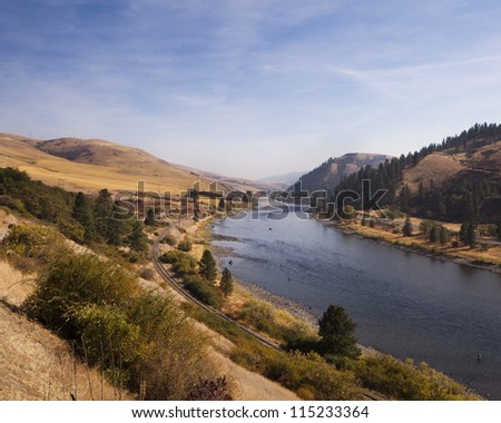 Several anglers spey casting on the river,  located in Idaho. - stock photo