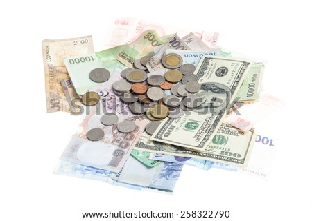 Several bank notes of american singapore indonesian thai korean and coins isolate on white background