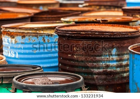 Several barrels of toxic waste at the dump - stock photo