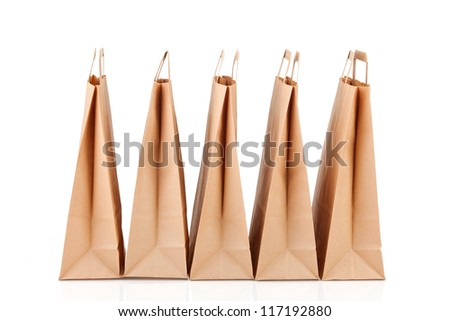 Several beige paper shopping bags. - stock photo