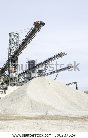 Several belt conveyors in Gravel Quarry  in cloudy day