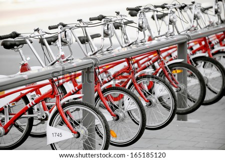 Several bikes for rent are seen in a velo station - stock photo