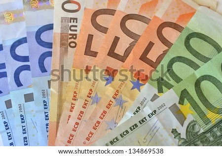 Several bills with different values ??of euros - stock photo