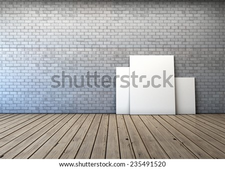 several blank picture in the empty room with white brick wall and wooden floor  - stock photo