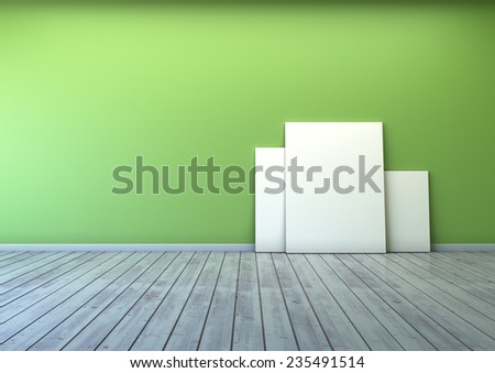 several blank picture in the green wall room and wooden floor  - stock photo