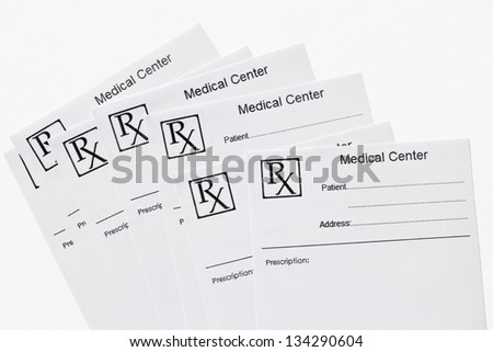 Several blank Rx prescriptions isolated on white.