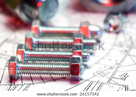 several bolts close up with shallow Dof,fill with red light - stock photo