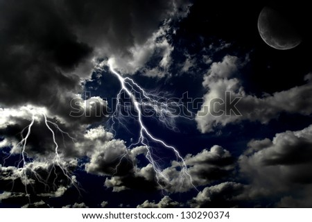 Several bolts of lightning in night sky with moon in the clouds - stock photo