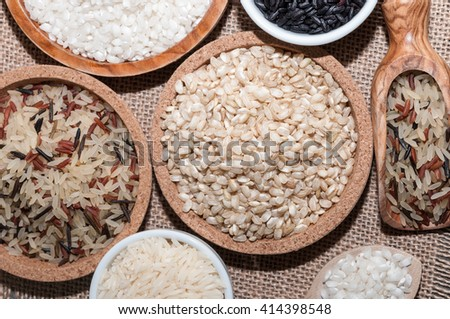 Several bowls with different rices on a tablecloth