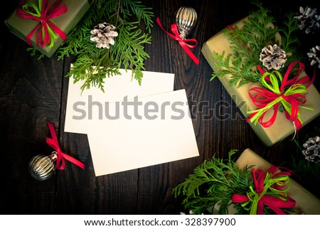 Several boxes of gifts wrapped in paper and decorated with ribbons. Top view, space for your greetings.