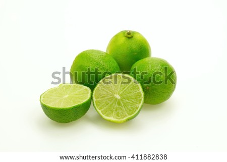 Several bright and fresh limes on white background.Isolated. - stock photo