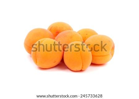 several bright apricots closeup, studioshot  - stock photo