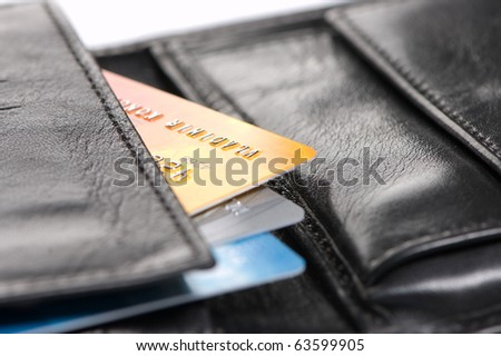 Several bright credit cards in a wallet