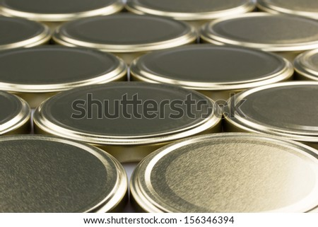 Several cap from cans on the table - stock photo