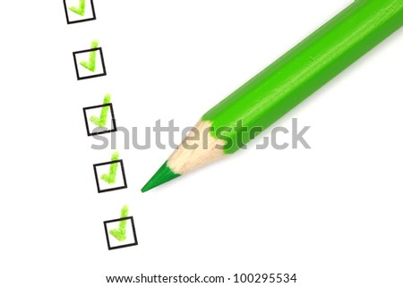 Several check boxes are marked with a green crayon. - stock photo