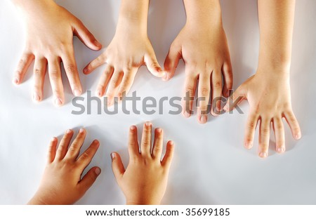 Several children hands together on white background - stock photo