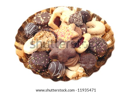 Several christmas cookies and pralines on golden christmas plate isolated on white background as a horizontal image - stock photo
