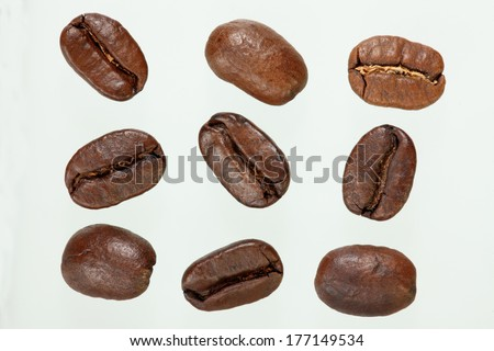 Several coffee beans isolated on white background