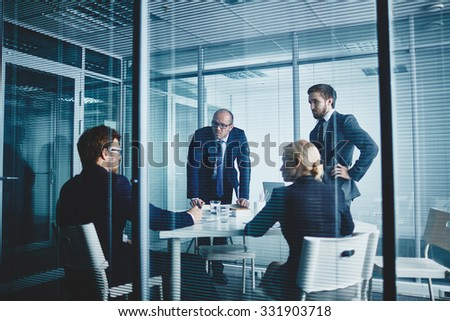 Several colleagues gathered in office for discussing plans - stock photo