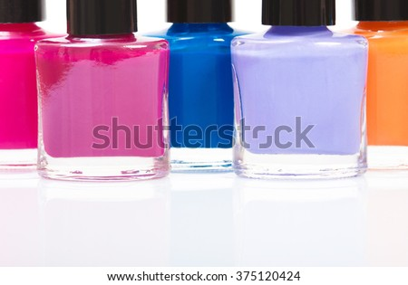 Several colored nail polish on a table