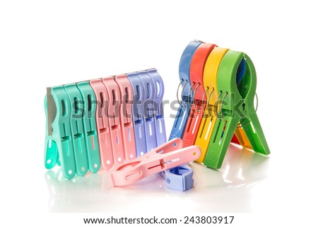 Several colored plastic clothespins with white background