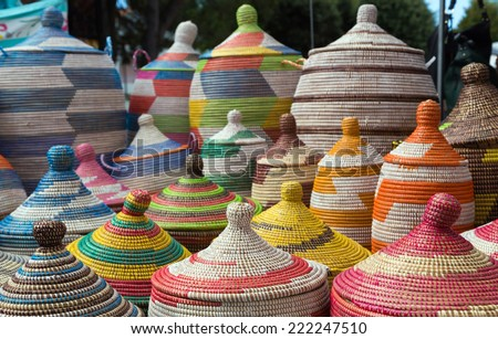several colorful african pot on the market - stock photo