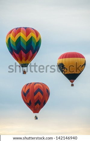 Several colorful hot air balloons rising - stock photo