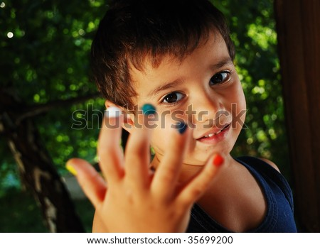 Several colors on children fingers, outdoor