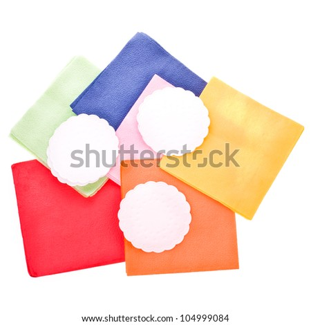 several colors. round and square napkins isolated on a white background - stock photo