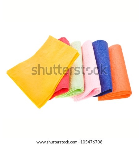 several colors square napkins isolated on a white background - stock photo