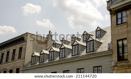 Several dormers on a roof - stock photo